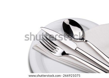 Fork, knife and spoon on a plate with napkin isolated on white. Clipping path. - stock photo