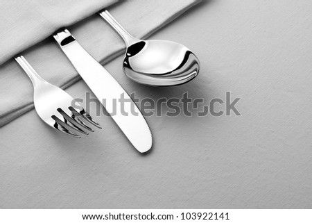 Fork, knife and spoon on the table - stock photo