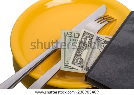 Fork, knife on yellow plate and and dollars isolated on white background - stock photo