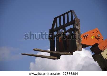fork lift into the blue sky - stock photo