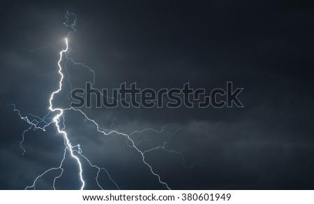 Fork lightning striking down during summer storm. - stock photo