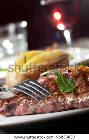 fork on a grilled steak - stock photo