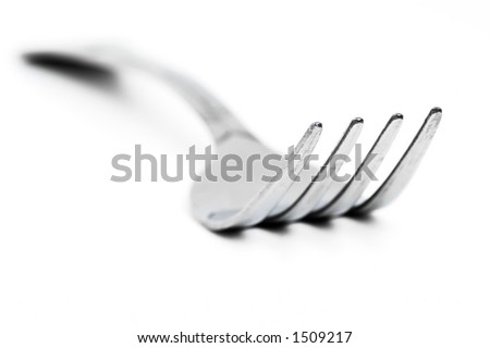 fork on a table - stock photo