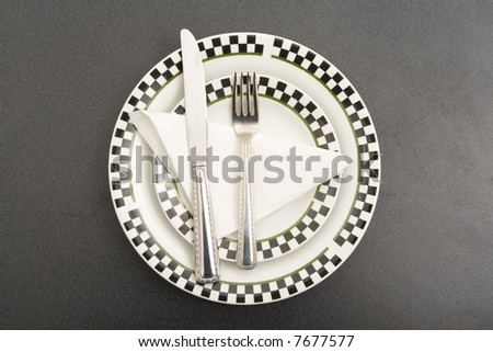 fork plate and knife on a table - stock photo