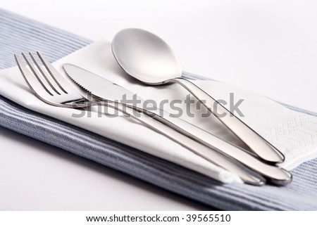 fork, spoon and knife on blue tableware