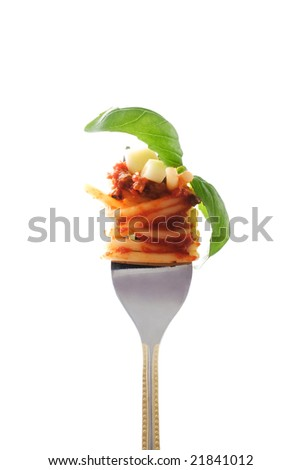 Fork wiht snack: spaghetti bolognese whit fresh garlic and basil - stock photo