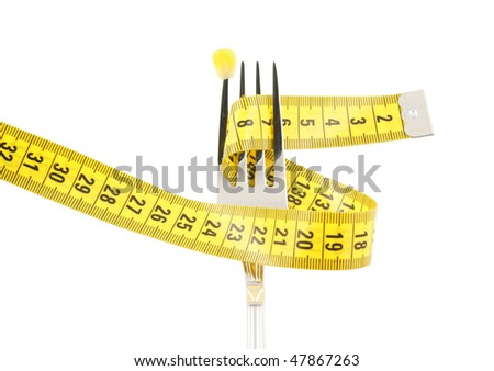 Fork with corn and measuring tape isolated