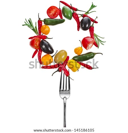 fork with falling olives with vegetables and herb spice, frame with copy space isolated on a white background - stock photo