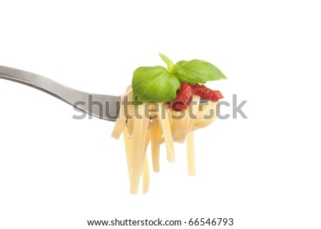 Fork with fresh cooked pasta, tomato sauce and fresh basil leaves on white background