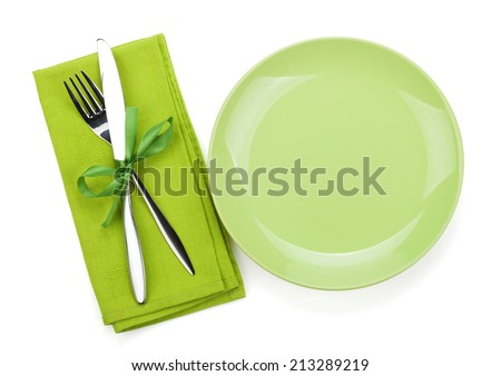 Fork with knife over towel and empty plate. Isolated on white background - stock photo