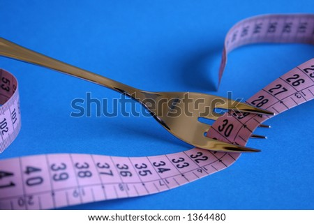 Fork with measuring tape around in blue background