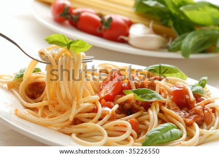 Fork with pasta and basil - stock photo