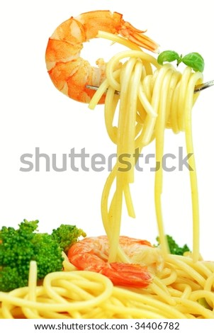 Fork with pasta and shrimp isolated on white - stock photo