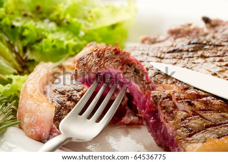 fork with slice t-bone - stock photo