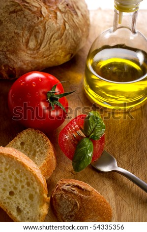 fork with slice tomato bread and olive oil - stock photo