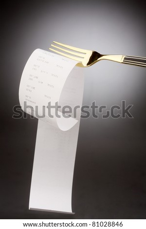 fork with the receipt on it - stock photo