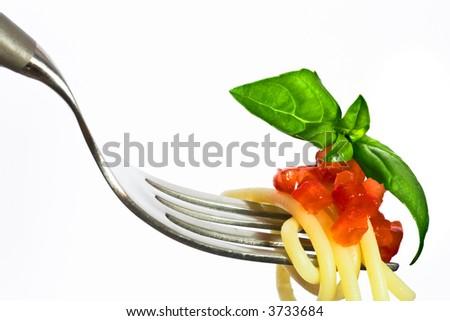 Fork with tomato pesto spaghetti - stock photo