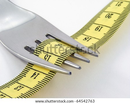 Fork with yellow measuring tape - Healthy life concept - stock photo