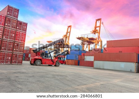 forklift at dockyard with big crane at harbor - stock photo