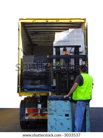 Forklift driver loading truck - stock photo