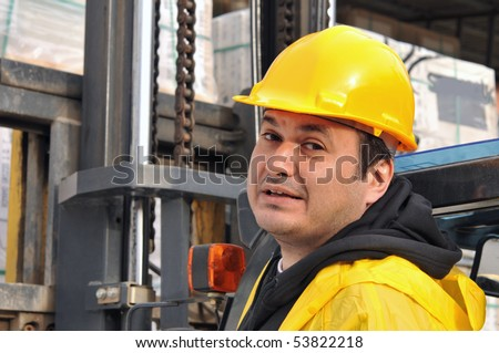Forklift driver looking at the camera - stock photo