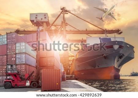 Forklift handling container box loading and Container Cargo freight ship with working crane bridge in shipyard at sunrise for Logistic Import Export background - stock photo