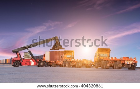 Forklift handling container box loading at the Docks with Truck - stock photo