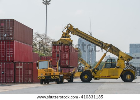 forklift handling container box loading to freight train - stock photo