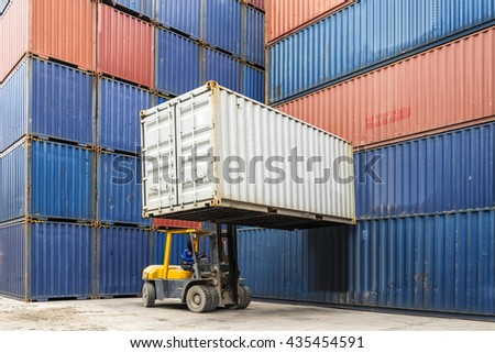 Forklift handling container box loading to freight train in logistics zone - stock photo