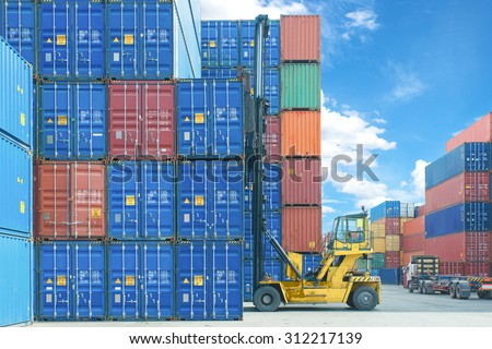 forklift handling container box loading to truck in import export logistic zone