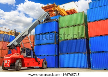 Forklift handling containers box at work  - stock photo