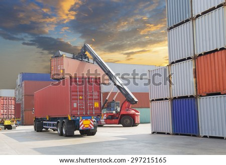 forklift handling the container box at dockyard with beautiful sky - stock photo