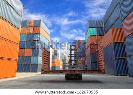 forklift handling the flat rack container box at dockyard - stock photo