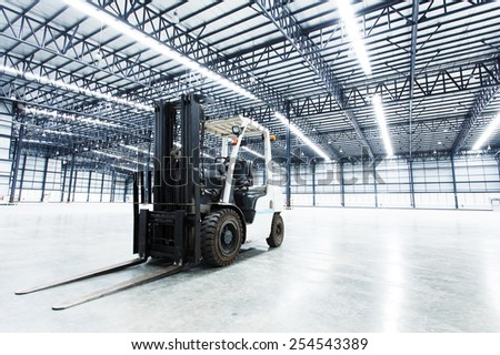Forklift in a warehouse - stock photo