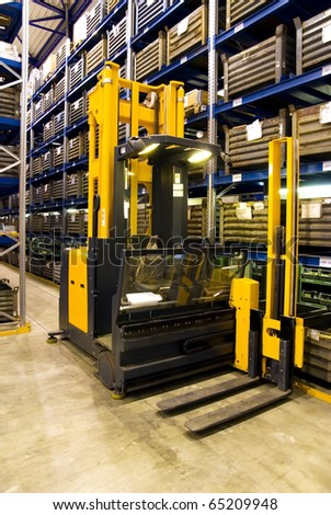 Forklift in warehouse, logistics, delivery of goods in storehouse. - stock photo