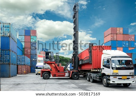 Forklift lift container box loading to truck in depot use for import export logistic background