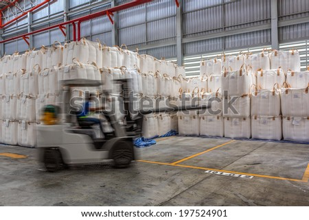 Forklift loader in warehouse with load jumbo bag  - stock photo