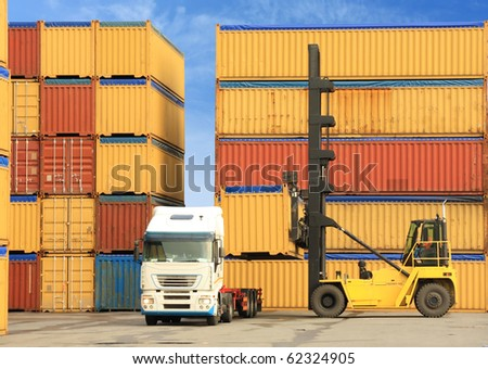 forklift loading containers on white truck in harbor - stock photo