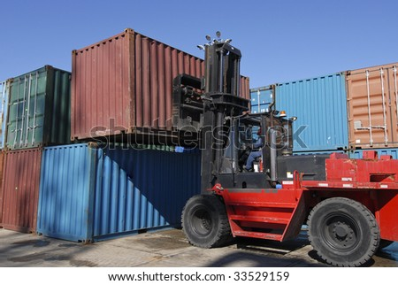 Forklift stacking containers outside