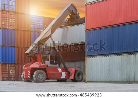 Forklift truck lifting cargo container box in logistic industrial area