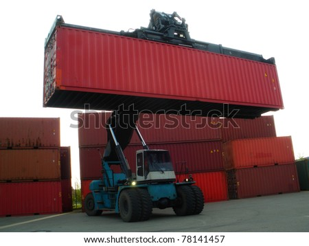 Forklift truck moving containers - stock photo