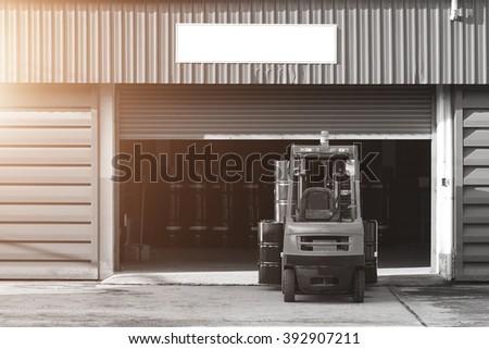 Forklift truck Oil truck - stock photo