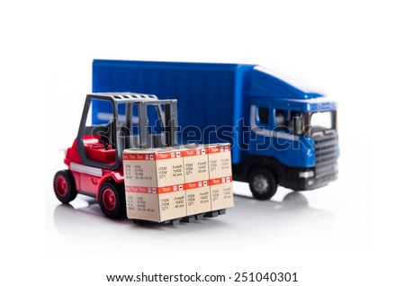 Forklift truck toys with boxes. Concept of international freight transport - stock photo
