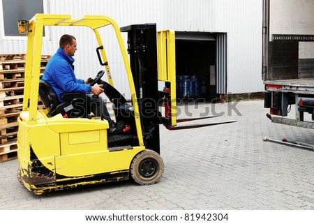 Forklift Truck with driver - stock photo