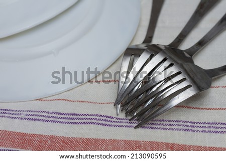 Forks and plates after washing. - stock photo