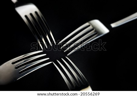 forks nicely arranged on black background