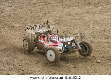 FORLI', ITALY - JULY 24: a rc model car in italian championship 1/10 buggy 4 wd, on July 24 2011 in Forli', Italy - off road race for radio controlled car with electric engine - stock photo