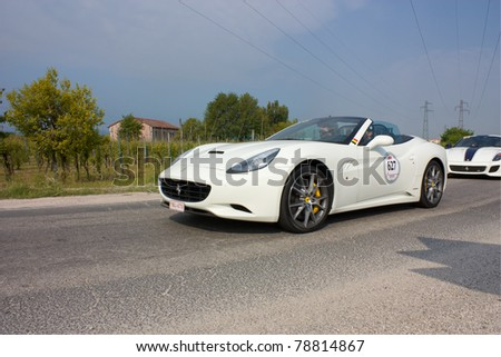 FORLI', ITALY - MAY 13: P. Cracco and G. Demuynk drive a Ferrari California in stage Bologna-Roma of the Ferrari Tribute to Mille Miglia, historical Italian race, on May 13, 2011 in Forli', Italy