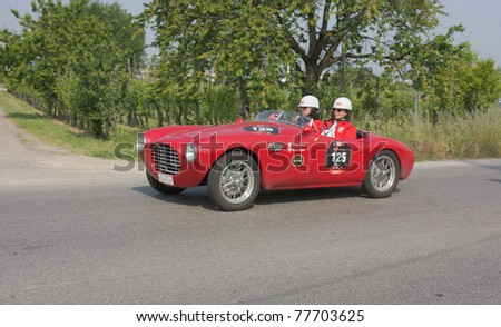 "FORLI', ITALY - MAY 13: S.M.A. Oberti and S.C. Royce drives a Siata 750 Spider BC (1951) in stage Bologna-Roma of the ""Mille miglia"" historical race for classic cars, on May 13, 2011 in Forli', Italy"