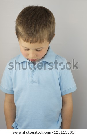 Forlorn Little Boy - stock photo